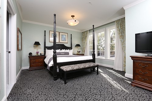 Royal Park's Hotel Room Bedroom with Love Seats in Rochester Michigan